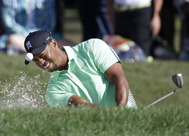 Tiger Woods hits out of a bunker on the 10th hole during the second round of the Honda Classic golf tournament, Friday, Feb. 28, 2014 in Palm Beach Gardens, Fla. (AP Photo/Wilfredo Lee)