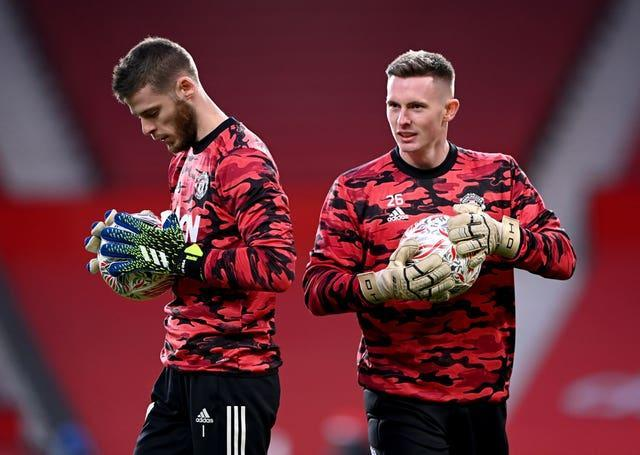 David De Gea, left, and Dean Henderson, right, are battling to be Manchester United's number one