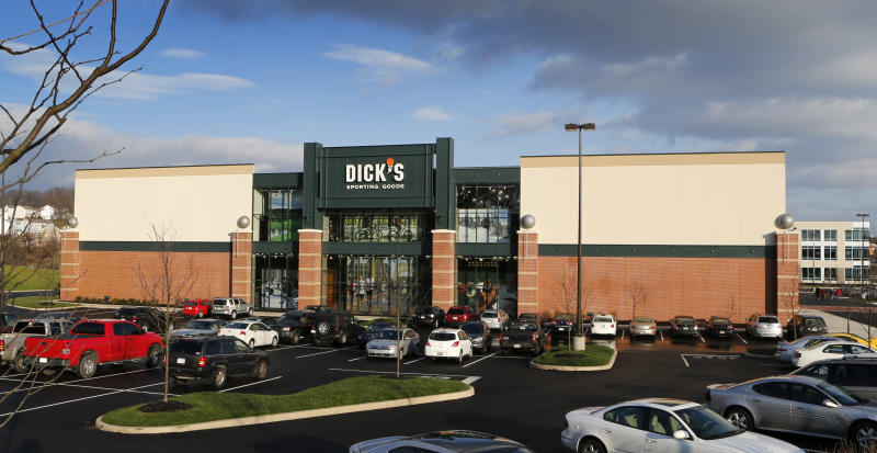 Cars are parked in the lot outside the Dicks Sporting Goods store in Cranberry, Pa. on Tuesday, Dec. 18, 2012. The sporting goods chain says it's suspending sales of modern rifles nationwide because of the school shooting in Connecticut. They also say it's removing all guns from display at its store closest to Newtown, where the massacre took place.(AP Photo/Keith Srakocic)