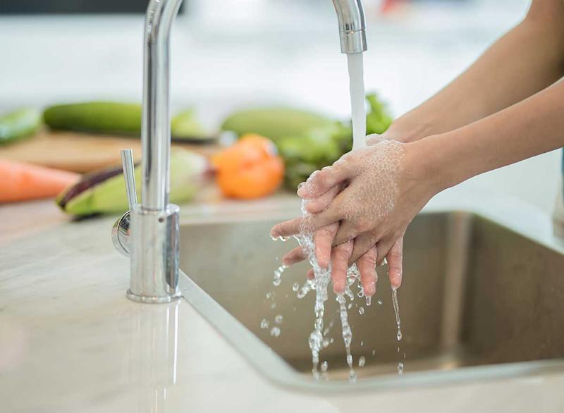 washing hands in kitchen