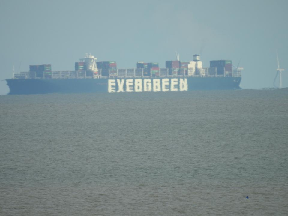 The Ever Given can be seen from Felixstowe waiting to berth in the Port of Felixstowe in Suffolk (Nigel Pickover/PA)
