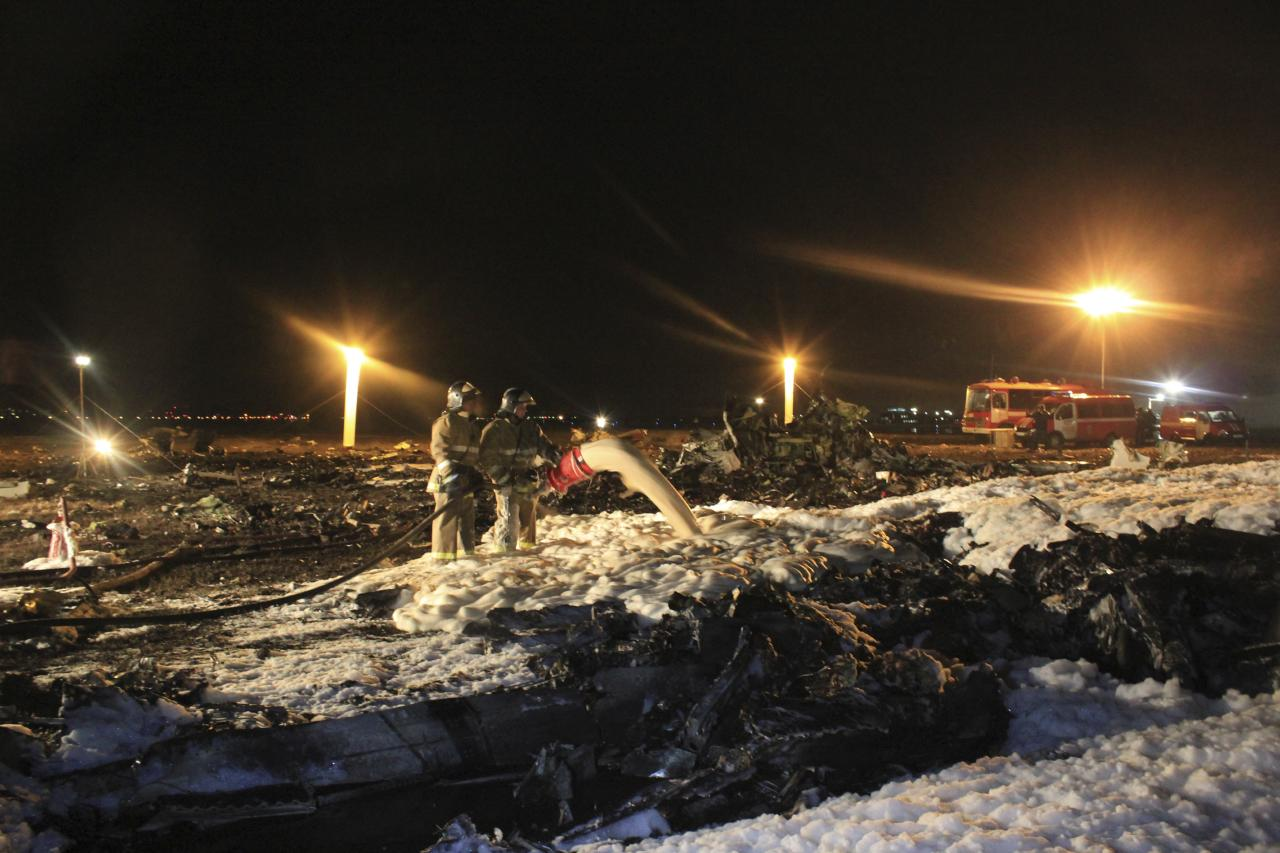 In this photo taken on Sunday, Nov. 17, 2013 and provided by Russian Emergency Situations Ministry fire fighters and rescuers work at the crash site of a Russian passenger airliner near Kazan, the capital of the Tatarstan republic, about 720 kilometers (450 miles) east of Moscow. A Russian passenger airliner crashed Sunday night while trying to land at the airport in the city of Kazan, killing all people aboard, officials said. The Boeing 737 belonging to Tatarstan Airlines crashed an hour after taking off from Moscow. There were no immediate indications of the cause. (AP Photo/Russian Emergency Situations Ministry)