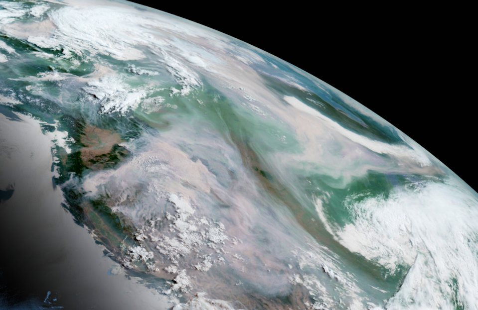 Satellite view of the Earth and wildfire smoke