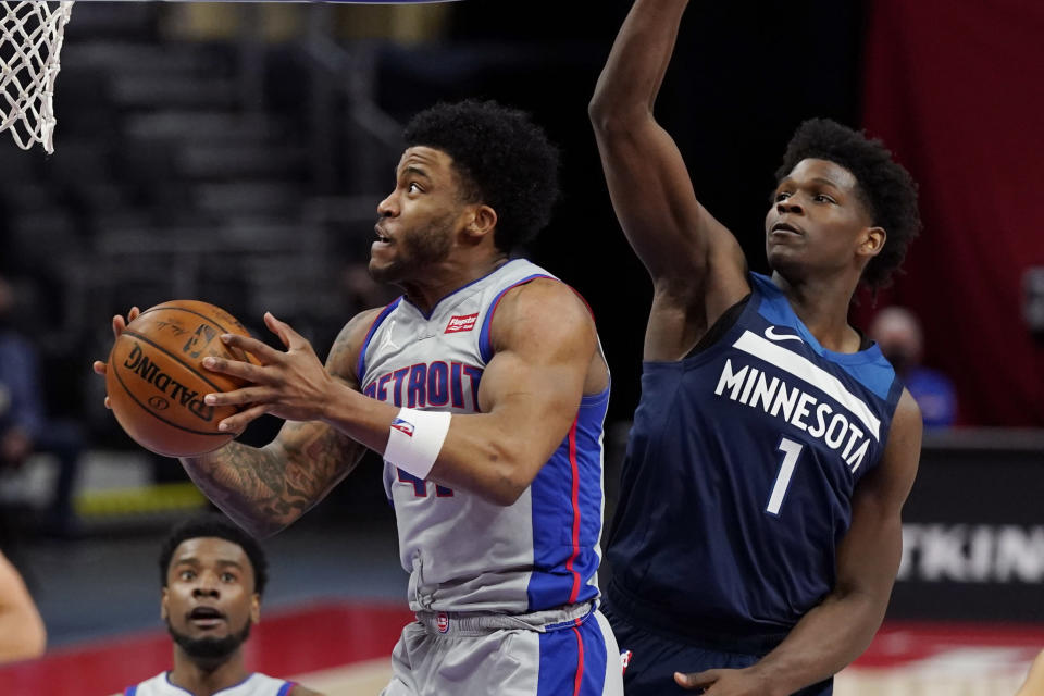 Detroit Pistons forward Saddiq Bey makes a lay up as Minnesota Timberwolves forward Anthony Edwards (1) defends during the second half of an NBA basketball game, Tuesday, May 11, 2021, in Detroit. (AP Photo/Carlos Osorio)