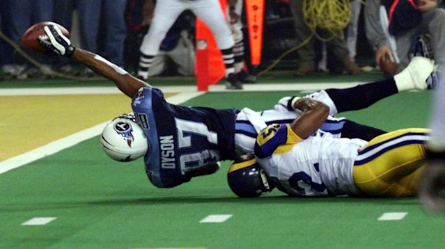 "Kevin Dyson tries but fails to get the ball into the end zone as he is tackled by St. Louis Rams' <a class=""link rapid-noclick-resp"" href=""/ncaaf/players/234818/"" data-ylk=""slk:Mike Jones"">Mike Jones</a> on the final play of Super Bowl XXXIV. (AP)"