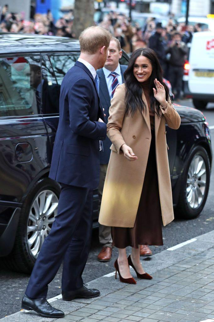 <p>For her first engagement of 2020, Meghan chose a camel-colored coat, which she wore over a brown turtleneck and midi-length skirt.</p>