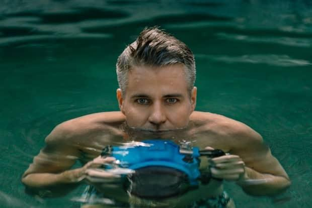 Dr. Lucas Murnaghan, who was renowned for his underwater photography, died early Tuesday at the age of 45. (Chee Sim/Submitted by Antonio Lennert - image credit)