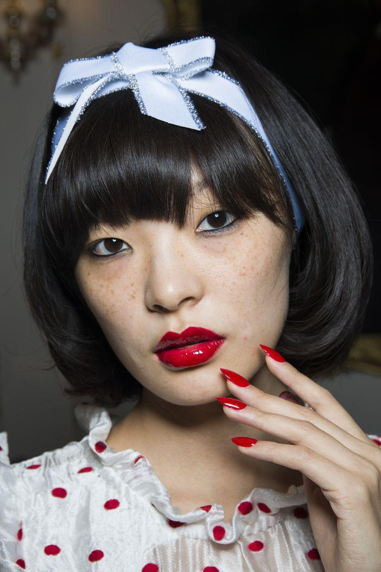 <p>Don't let the headband and pola dots fool you-there's nothing sweet about this cherry-red vinyl lip with smudgy black eyeliner. </p>