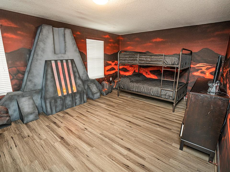 """The walls are covered in lava artwork. <p class=""""copyright"""">Loma Homes</p>"""