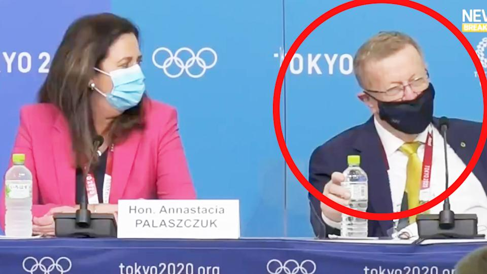 AOC president John Coates (pictured right) talking about Queensland Premier Annastacia Palaszczuk (pictured left) who seems shocked at his words in Tokyo.