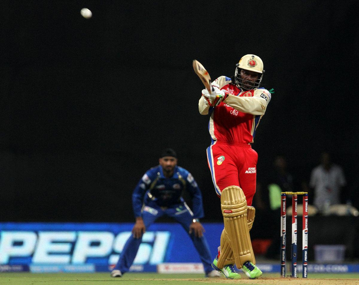 Royal Challengers Bangalore player Chris Gayle plays a shot during match 37 of the Pepsi Indian Premier League ( IPL) 2013  between The Mumbai Indians and the Royal Challengers Bangalore held at the Wankhede Stadium in Mumbai on the 27th April 2013. (BCCI)