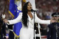 Demi Lovato performs the national anthem before the NFL Super Bowl 54 football game between the Kansas City Chiefs and the San Francisco 49ers Sunday, Feb. 2, 2020, in Miami Gardens, Fla. (AP Photo/Seth Wenig)