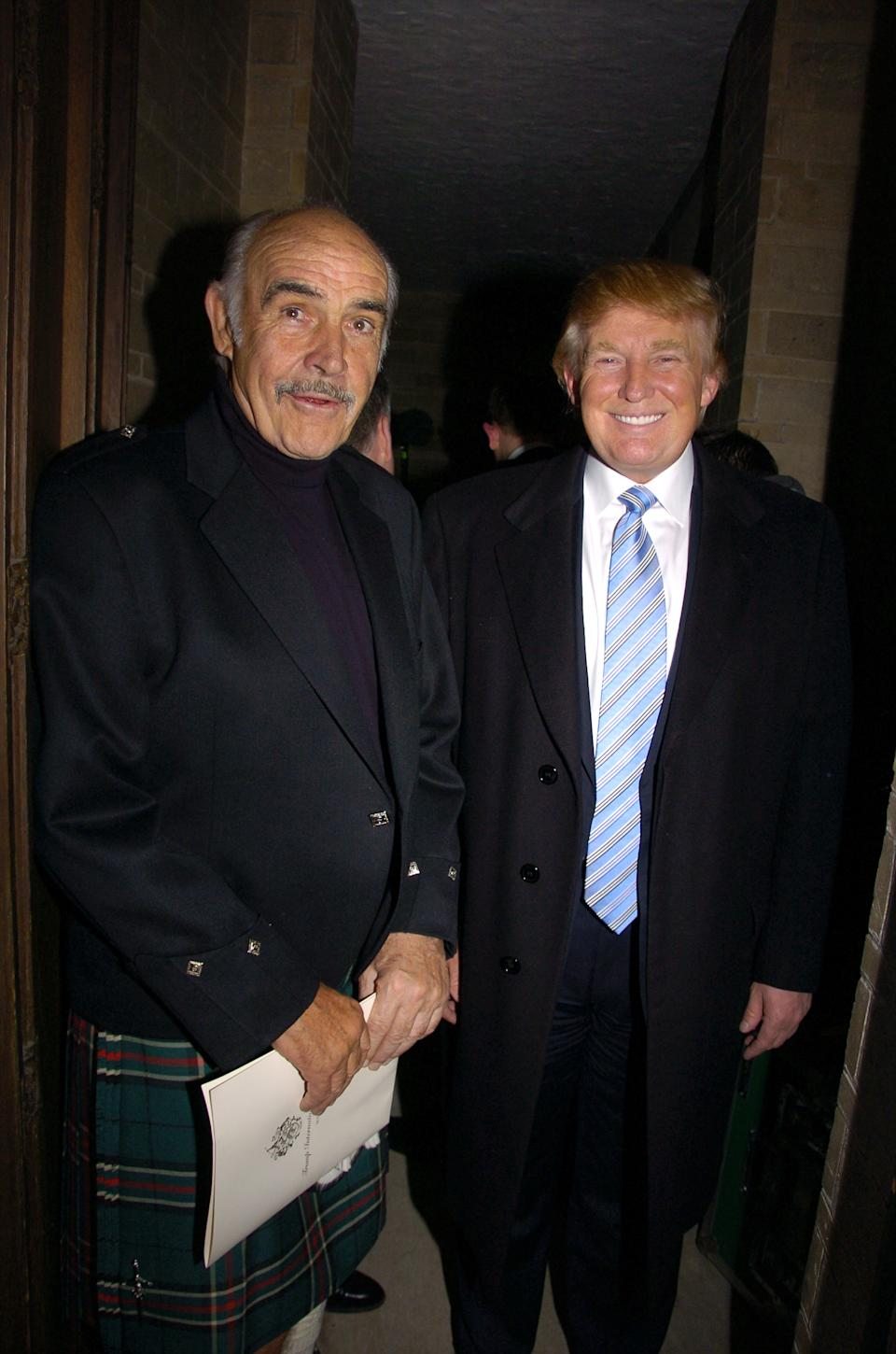 UNITED STATES - APRIL 03:  Sean Connery (left) and Donald Trump are at the Synod House at St. John the Divine Cathedral Garden for the Johnnie Walker Dressed to Kilt fashion show and charity event.  (Photo by Richard Corkery/NY Daily News Archive via Getty Images)