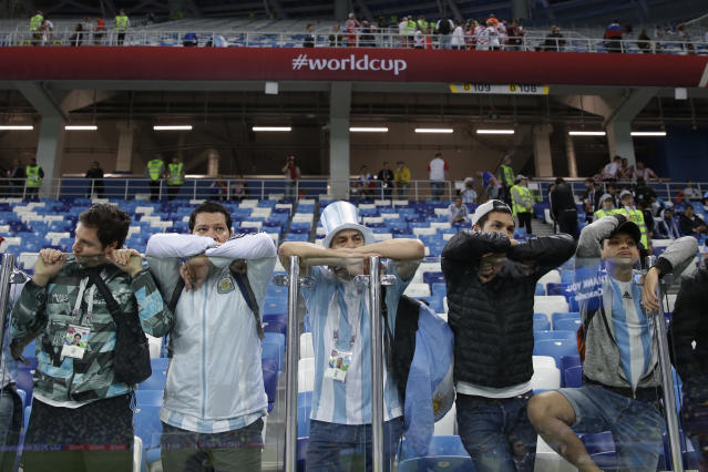 Fans of Argentina lean against the security glass after their side's 0-3 lost against Croatia during the group D match at the 2018 soccer World Cup in Nizhny Novgorod, Russia, Thursday, June 21, 2018. (AP Photo/Ricardo Mazalan)