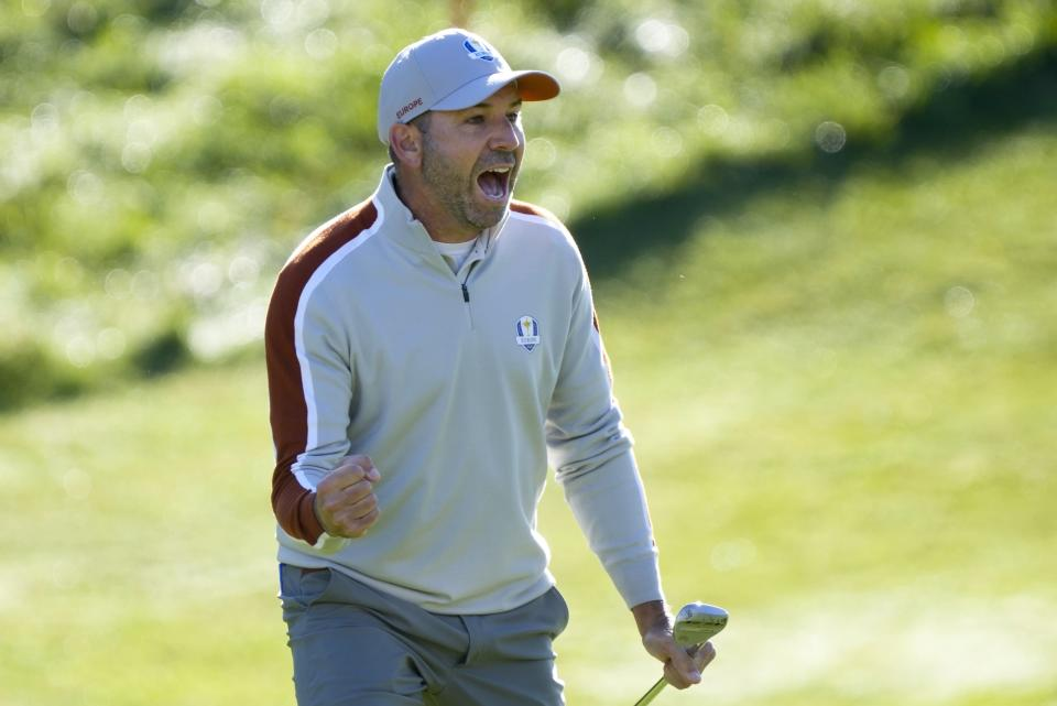 Team Europe's Sergio Garcia reacts after making a putt on the ninth hole during a foursomes match the Ryder Cup at the Whistling Straits Golf Course Saturday, Sept. 25, 2021, in Sheboygan, Wis. (AP Photo/Charlie Neibergall)
