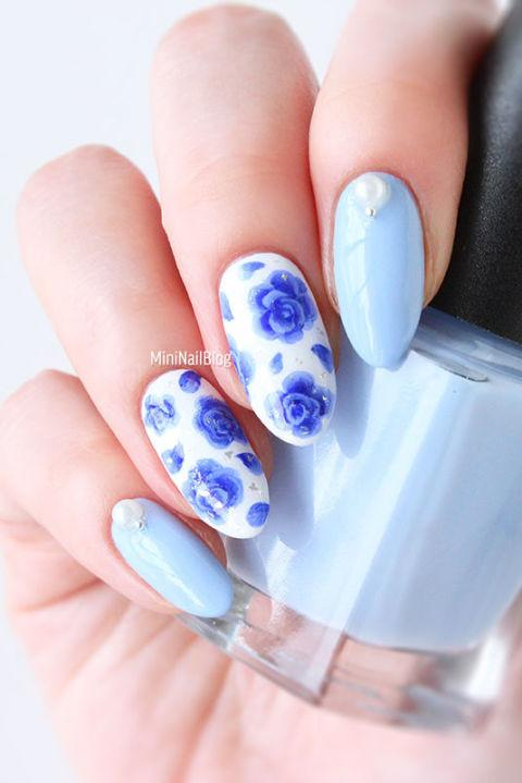 "<p>Not ready to take the full floral plunge? Take inspiration from your favorite blue china and decorate an accent nail or two with delicate roses. This nail artist topped hers off with <a rel=""nofollow"" href=""https://www.amazon.com/White-Pearl-Stone-Different-Rhinestones/dp/B00C4207LY/ref=sr_1_4_s_it?tag=syndication-20"">pearl beads</a>.</p><p><em><a rel=""nofollow"" href=""https://nailbees.com/blue-rose-nail-art"">See more at Nailbees »</a><em> </em></em></p>"