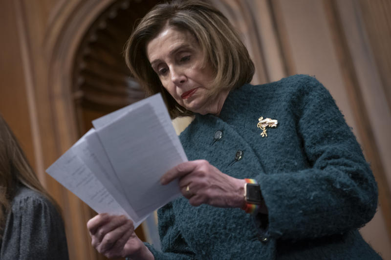 Speaker of the House Nancy Pelosi, D-Calif., reads a note handed to her from an aide as she attends a health care event at the Capitol in Washington, Wednesday, Dec. 11, 2019.  (AP Photo/J. Scott Applewhite)