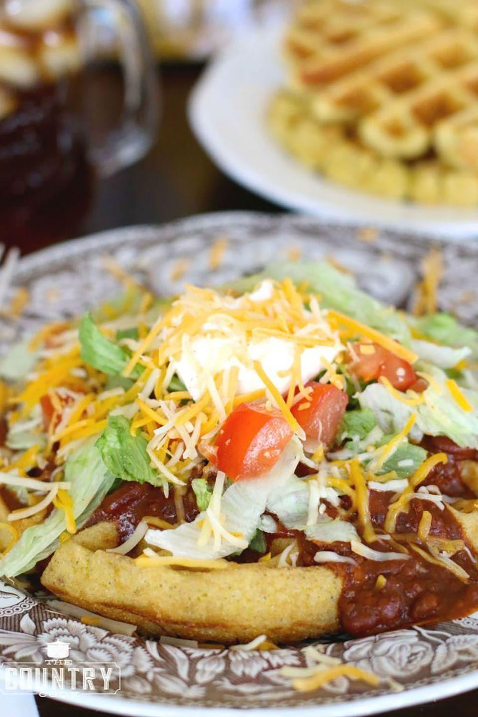"""<p>Switch up breakfast for dinner with some Mexican-style, savory waffles.</p><p><strong>Get the recipe at <a href=""""https://www.thecountrycook.net/cornbread-waffles-with-chili-fixins/"""" rel=""""nofollow noopener"""" target=""""_blank"""" data-ylk=""""slk:The Country Cook"""" class=""""link rapid-noclick-resp"""">The Country Cook</a>.</strong><br></p>"""