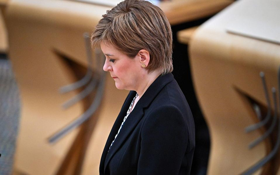 Nicola Sturgeon joins Scottish political party leaders as they take part in a motion of condolence for The Duke of Edinburgh at Scottish Parliament on Monday - PA