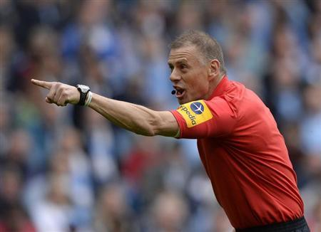 Referee Mark Halsey gestures during the English Premier League soccer match between Manchester City and Norwich City in Manchester, northern England May 19, 2013. REUTERS/Nigel Roddis