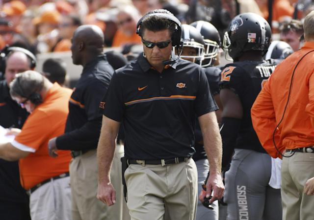 Oklahoma State and coach Mike Gundy won't go undefeated. (Getty)