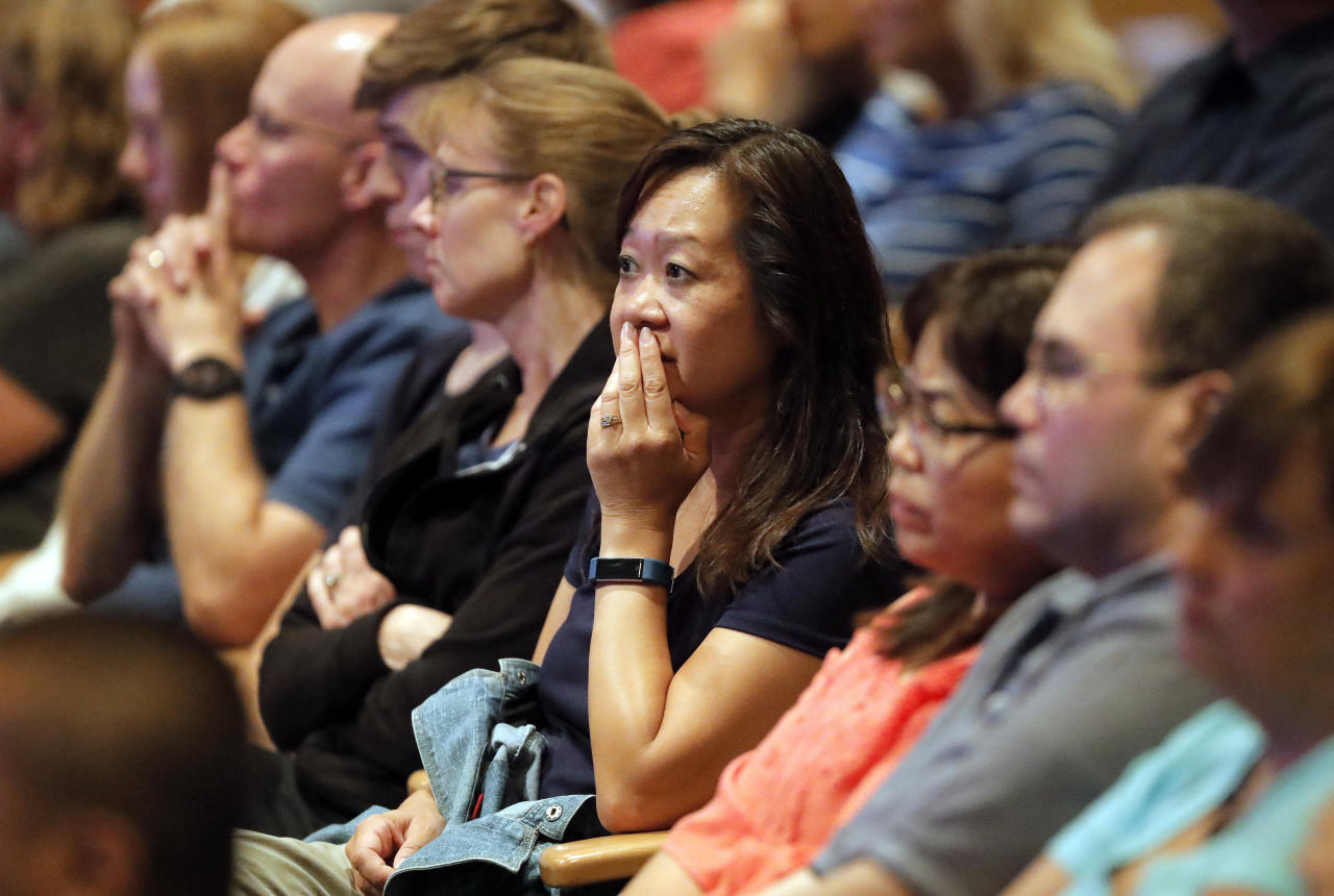FILE - In this Wednesday, Aug. 8, 2018 file photo, audience members react as it was announced at Willow Creek Community Church in South Barrington, Ill., that lead pastor Heather Larson is stepping down, and the entire Board of Elders will do so by the end of the year. Larson said the church needed new leadership in the wake of sexual harassment allegations against church founder Bill Hybels. (Steve Lundy/Daily Herald via AP)
