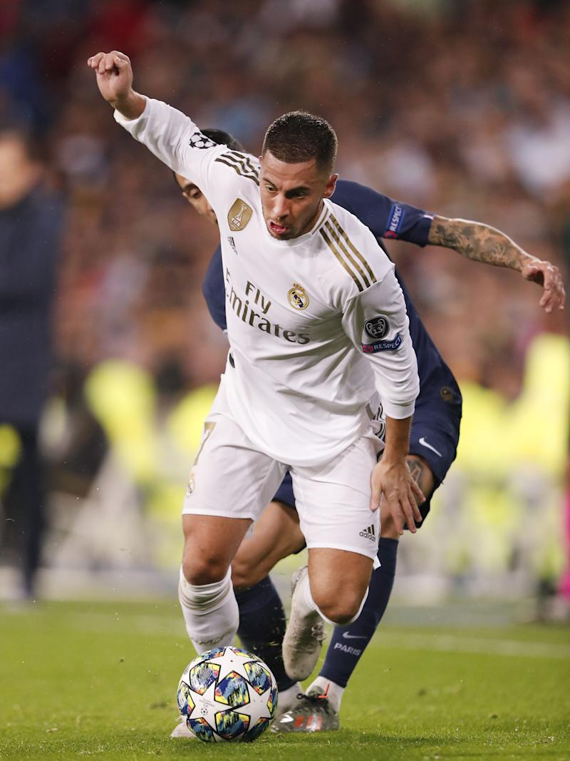 (L-R) Angel Di Maria of Paris Saint-Germain, Eden Hazard of Real Madrid during the UEFA Champions League group A match between Real Madrid and Paris Saint-Germain at the Santiago Bernabeu stadium on November 26, 2019 in Madrid, Spain(Photo by ANP Sport via Getty Images)