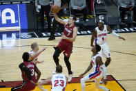Miami Heat guard Goran Dragic (7) shoots over Detroit Pistons center Mason Plumlee, left, forward Blake Griffin (23) and forward Jerami Grant (9) during the second half of an NBA basketball game, Saturday, Jan. 16, 2021, in Miami. (AP Photo/Lynne Sladky)