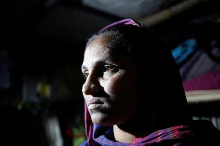 Rohingya Muslim refugee Sanmaraz, whose husband is in prison on charges of carrying ya ba, poses for a picture inside her room in the Leda Unregistered Refugee Camp, in Teknaf, Bangladesh, February 15, 2017. REUTERS/Mohammad Ponir Hossain