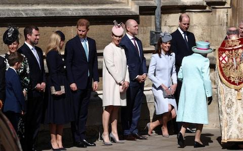 The Queen is greeted by her family at church - Credit: Adam Gray / SWNS