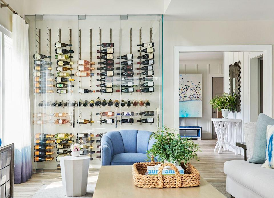 """<p>A closet-sized wine cellar can fit in a living room corner while still housings an extensive bottle collection. Just make sure you use the right glass for optimal wine storage, and """"be conscious of your exposed, says designer <a href=""""https://www.morganharrisonhome.com/"""" rel=""""nofollow noopener"""" target=""""_blank"""" data-ylk=""""slk:Michelle Morgan Harrison"""" class=""""link rapid-noclick-resp"""">Michelle Morgan Harrison</a>. Too much direct sunlight accelerates aging, so UV-filtering glass and low-voltage LED bulbs will do wonders. </p>"""