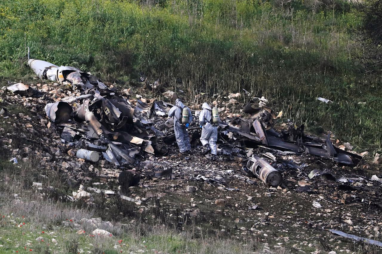 <p>Israeli security forces examine the remains of an F-16 Israeli war plane near the Israeli village of Harduf, Israel, Feb. 10, 2018. (Photo: Ronen Zvulun/Reuters) </p>