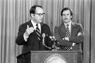 FILE - In this March 30, 1979 file photo, Pennsylvania Gov. Dick Thornburgh, left, announces the closing of schools in the area around the Three Mile Island PWR in Harrisburg, Pa., after an accident at the nuclear power plant led to the release of radioactive gas from the reactor into the atmosphere. Thornburgh died Thursday, Dec. 31, 2020 at a retirement community facility outside Pittsburgh, his son David said. The cause it not yet known. (AP Photo, File)