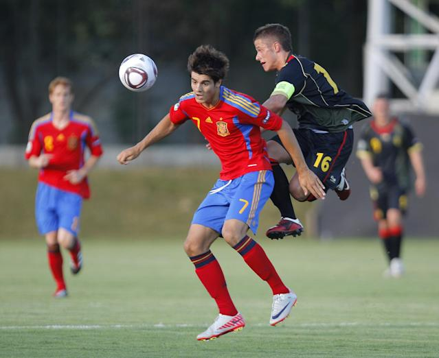 Alvaro Morata (L) of Spain vies for the ball with Florent Cuvelier (R) of Belgium during their UEFA European Under-19 Championship 2010/2011 football final tournament in Mogosoaia village, next to Bucharest on July 21, 2011. AFP PHOTO/ STRINGER (Photo credit should read -/AFP/Getty Images)