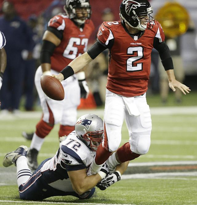Atlanta Falcons quarterback Matt Ryan (2) is sacked by New England Patriots defensive tackle Joe Vellano (72) during the second half of an NFL football game, Sunday, Sept. 29, 2013, in Atlanta. (AP Photo/John Bazemore)