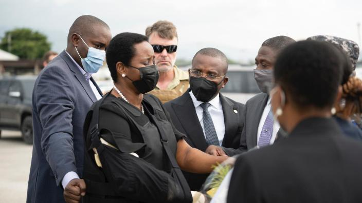 In this handout photo released by Haiti's Secretary of State for Communication, Haiti's first lady Martine Moise, wearing a bullet proof vest and her right arm in a sling, arrives at the Toussaint Louverture International Airport, in Port-au-Prince, Haiti, Saturday, July 17, 2021. Martine Moise, the wife of assassinated President Jovenel Moise, who was injured in the July 7 attack at their private home, returned to the Caribbean nation on Saturday following her release from a Miami hospital. (Haiti's Secretary of State for Communication Photo/via AP)