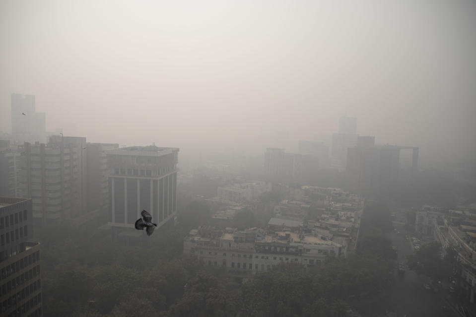 Smog envelopes the skyline in New Delhi, India, Wednesday, Nov. 4, 2020. A thick quilt of smog lingered over the Indian capital and its suburbs on Friday, fed by smoke from raging agricultural fires that health experts worry could worsen the city's fight against the coronavirus. Air pollution in parts of New Delhi have climbed to levels around nine times what the World Health Organization considers safe, turning grey winter skies into a putrid yellow and shrouding national monuments. (AP Photo/Altaf Qadri)