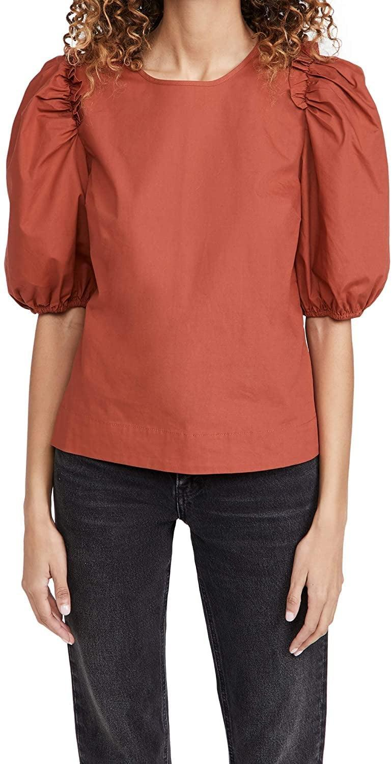 <p>This <span>English Factory Poplin Puff Sleeve Top</span> ($36) adds drama and style to any look.</p>