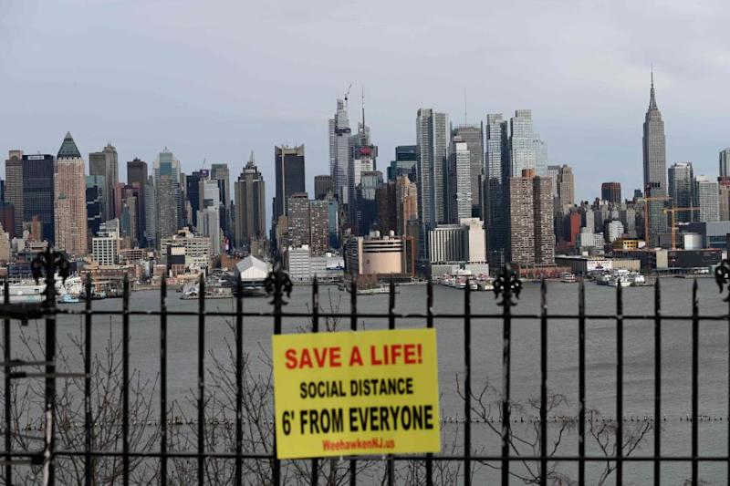 A sign hangs in a park overlooking the Manhattan skyline as seen from Weehawken, New Jersey.