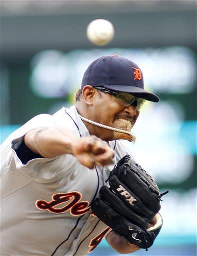 Detroit Tigers relief pitcher Jose Valverde throws to the Minnesota Twins in the ninth inning of their baseball game in Minneapolis, Saturday, May 26, 2012. (AP Photo/Andy King)