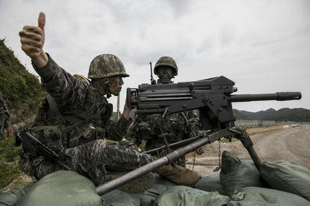 FILE PHOTO: South Korean marines take part in a military exercise on South Korea's Baengnyeong Island, near the disputed sea border with the north, in this handout picture provided by South Korean Marine Corps and released by Yonhap, September 7, 2017. South Korean Marine Corps/Yonhap via REUTERS