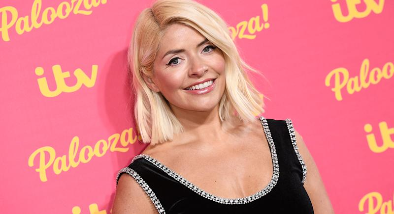 Holly Willoughby never fails to impress with her style choices; from the glamorous red carpet look at the ITV Palooza in 2019, to her daytime outfits on This Morning. (Getty Images)