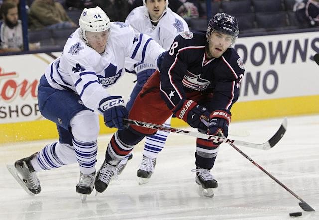 Columbus Blue Jackets' Boone Jenner, right, controls the puck as Toronto Maple Leafs' Morgan Reilly defends during the second period of an NHL hockey game on Friday, Oct. 25, 2013, in Columbus, Ohio. (AP Photo/Jay LaPrete)