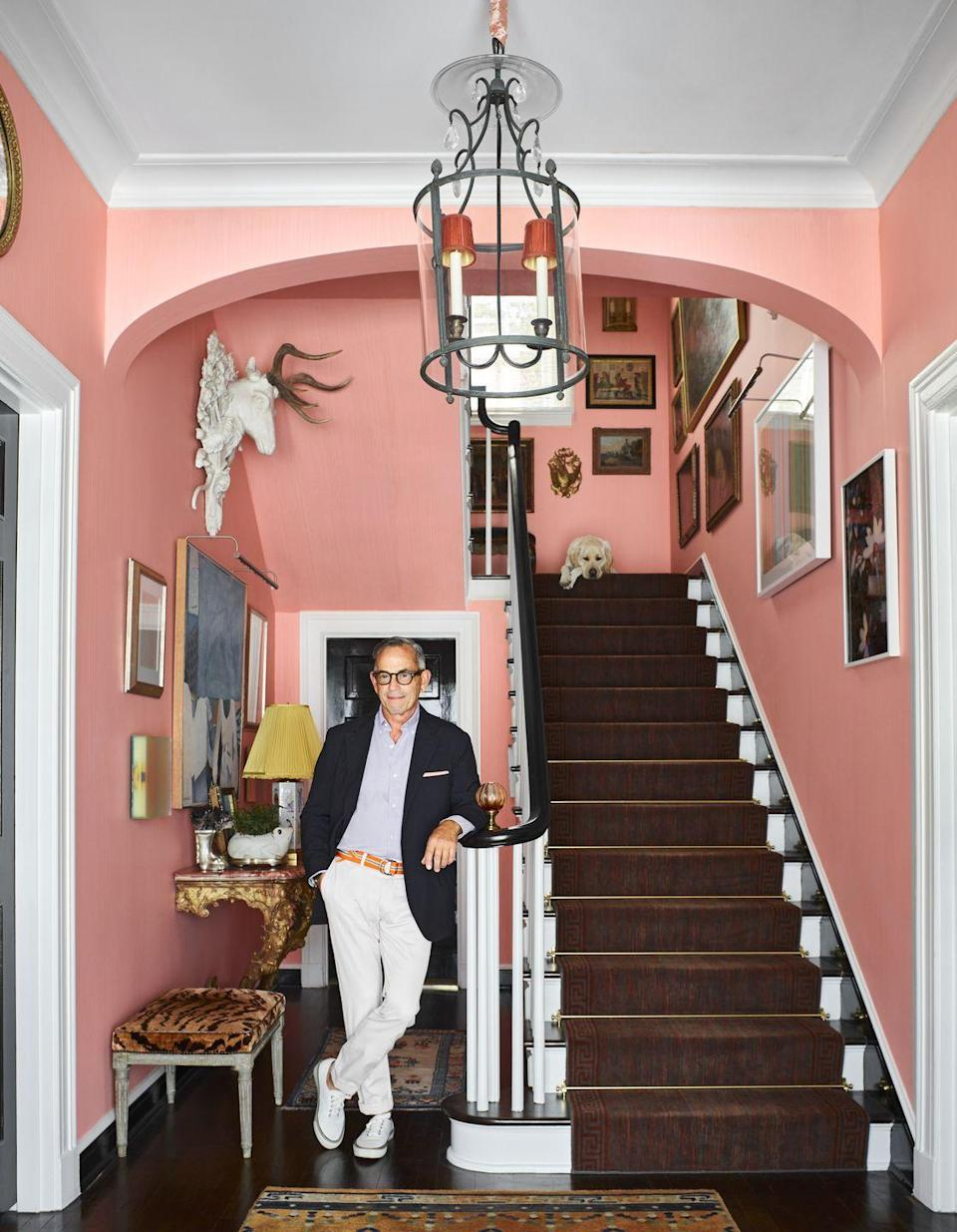 """<p><a href=""""https://www.veranda.com/decorating-ideas/house-tours/a36082856/todd-romano-san-antonio-home-tour/"""" rel=""""nofollow noopener"""" target=""""_blank"""" data-ylk=""""slk:Todd Romano's striking San Antonio home"""" class=""""link rapid-noclick-resp"""">Todd Romano's striking San Antonio home </a>is full of lively artwork mixed with traditional design for a one-of-a-kind home that shows restraint when needed. Here, Romano shows off a staircase that has been painted black and white, acting as a perfect foil for the pink walls. </p>"""