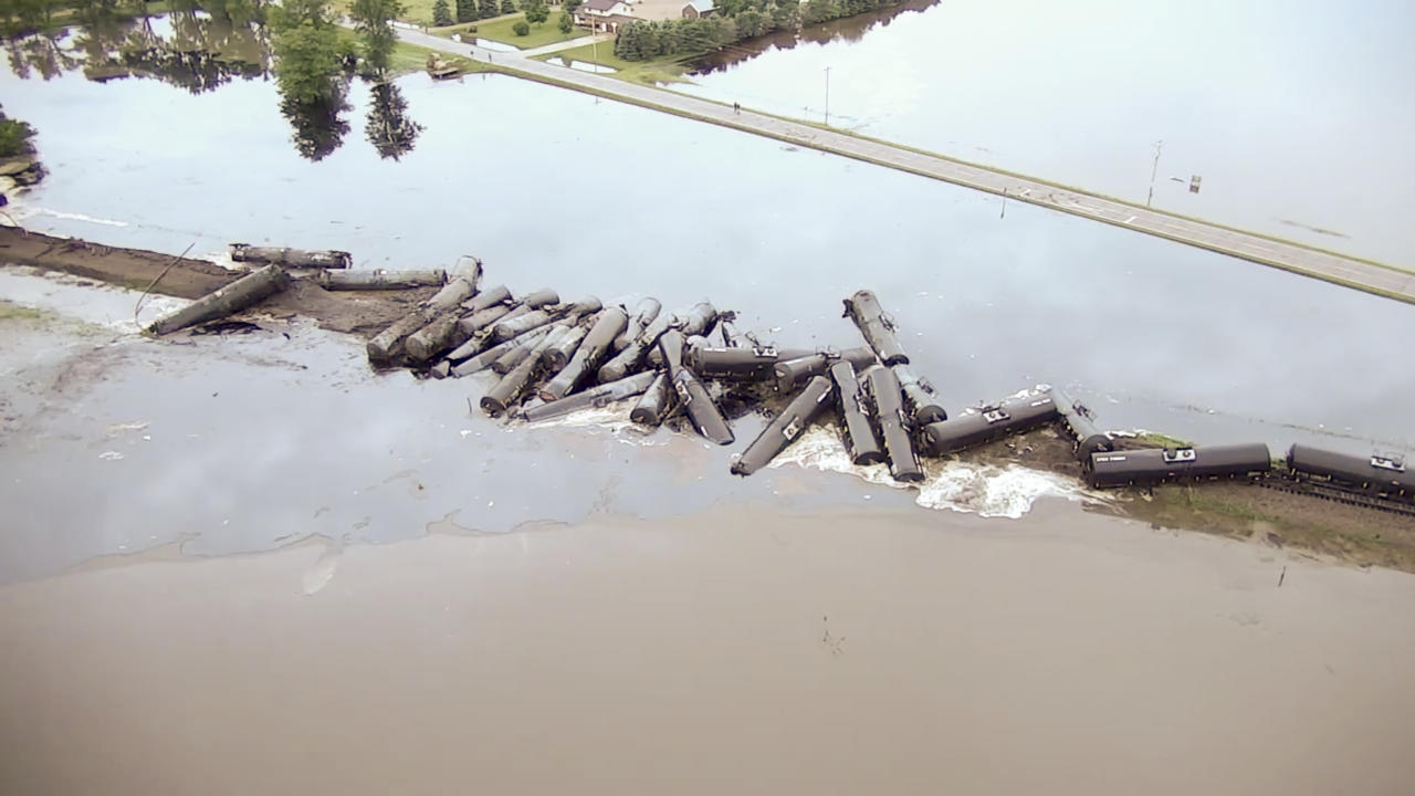 <p> In this aerial drone image taken from video and provided by the Sioux County Sheriff's Office, tanker cars carrying crude oil are shown derailed about a mile south of Doon, Iowa, Friday, June 22, 2018. About 31 cars derailed after the tracks reportedly collapsed due to saturation from flood waters from adjacent Little Rock River. (Sioux County Sheriff's Office via AP) </p>