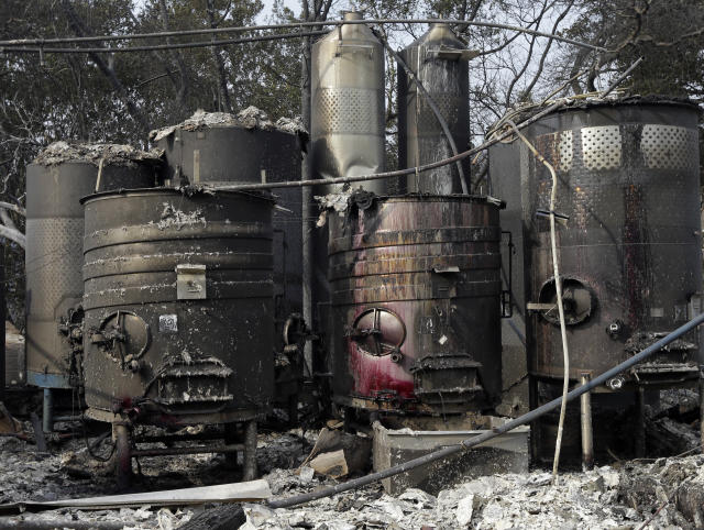 <p>Damaged wine making vats and tanks due to a wildfire stand in ashes and debris at the production house of Paradise Ridge Winery on Tuesday, Oct. 10, 2017 in Santa Rosa, Calif. (Photo: Ben Margot/AP) </p>