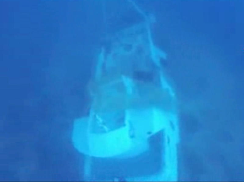 In this image made from video provided by Italian Firefighters, a boat lies underwater, Friday, Oct. 4, 2013, that was transporting hundreds of migrants before catching fire and sinking off the Sicilian island of Lampedusa, Italy, on Thursday. (AP Photo/Italian Firefighters)