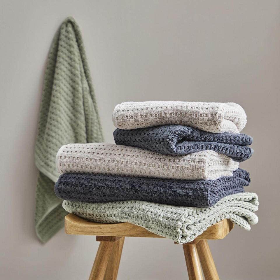"""<p>Made from 100% cotton, these towels come in a tasteful edit of soft, natural colours ('Sage', 'Mushroom' and 'Graphite' pictured) and offer a textural quality that belies their affordable price tag. From £6 each, <a href=""""https://www.dunelm.com/product/sage-green-waffle-100-cotton-towel-1000186086"""" rel=""""nofollow noopener"""" target=""""_blank"""" data-ylk=""""slk:dunelm.com"""" class=""""link rapid-noclick-resp"""">dunelm.com</a></p>"""