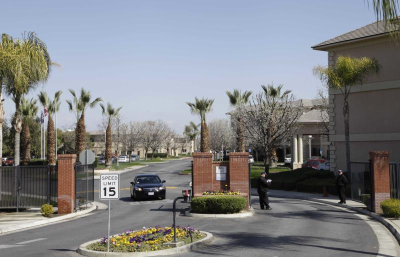 "A car passes through the gate of Glenwood Gardens in Bakersfield, Calif., Monday March 4, 2013, where an elderly woman died after a nurse refused to perform CPR on her last week. The central California retirement home is defending one of its nurses who refused pleas by a 911 operator to perform CPR on an elderly woman, who later died. ""Is there anybody that's willing to help this lady and not let her die,"" dispatcher Tracey Halvorson says on a 911 tape released by the Bakersfield Fire Department aired by several media outlets. (AP Photo/Gosia Wozniacka)"