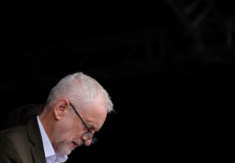 DURHAM, ENGLAND - JULY 13: Labour leader Jeremy Corbyn checks his notes before he addresses the crowd during the 135th Durham Miners Gala on July 13, 2019 in Durham, England. Over two decades after the last pit closed in the Durham coalfield the Miners Gala or Big Meeting as it is known locally remains as popular as ever with close to 200,000 people expected to attend this year. The gala forms part of the culture and heritage of the area and represents the communal values of the North East of England. The gala sees traditional colliery brass bands march through the city ahead of their respective pit banners before pausing to play outside the County Hotel building where union leaders, invited guests and dignitaries gather before they then continue to the racecourse area for a day of entertainment and speeches. Beginning in 1871 the gala is the biggest trade union event in Europe and is part of an annual celebration of socialism. This year also marks the 150th anniversary of the Durham Miners' Association. The gala is hosted by the DMA who also provide a range of services for its members, made up from former Durham miners, including compensation claims, benefit information, tribunal representation and legal advice. (Photo by Ian Forsyth/Getty Images)